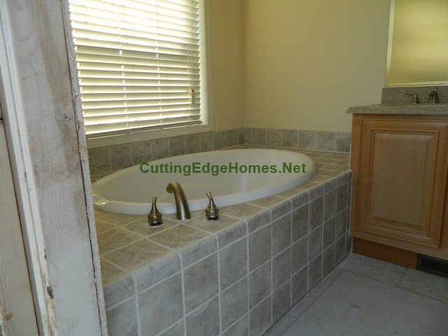Highland Cape with Unfinished Attic: Master Bath Tub with Optional Factory Tile Finish